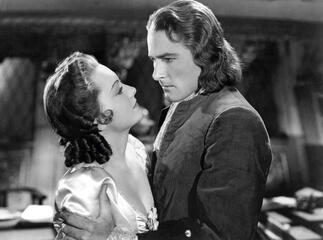 Olivia de Havilland und Errol Flynn in Unter Piratenflagge