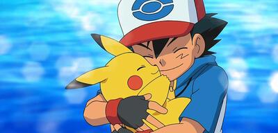Ash und Pikachu freuen sich