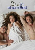Drei in einem Bett