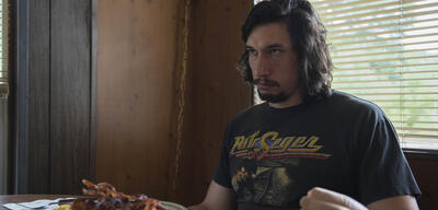 Adam Driver in Lucky Logan