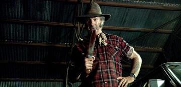 John Jarrat als Mick Taylor in Wolf Creek