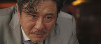 Oldboy-Darsteller Min-sik Choi als Kidnapper im aktuellen Kinofilm Lucy