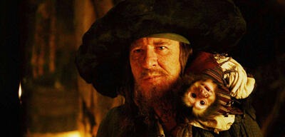 Geoffrey Rush als Barbossa und Affe Jack