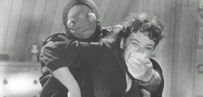Der Frosch mit der Maske (links)