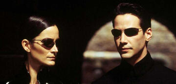 Trinity (Carrie Anne-Moss) und Neo (Keanu Reeves)