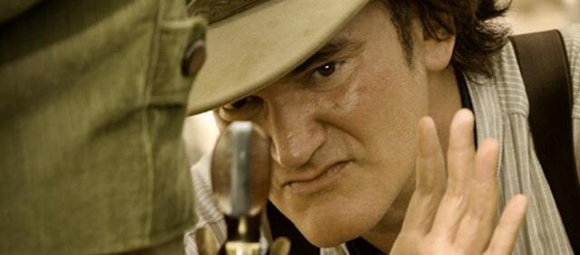 Sitzt! Quentin Tarantino inspiziert Jamie Foxx' Allerwertesten.