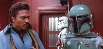 Bild zu:  Ein skeptischer Lando Calrissian neben Boba Fett