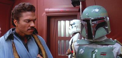 Ein skeptischer Lando Calrissian neben Boba Fett