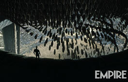 Eine Figur umgeben von den Pods aus Prometheus Bildergalerie Detail-Ansicht